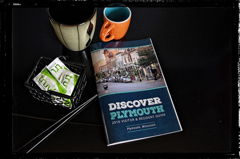 Sun Graphics Media can help boost your sales with traditional marketing. Photo of an advertising book for Discover Plymouth.